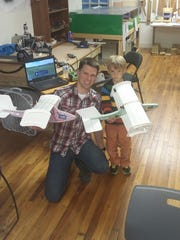 Peter Denbigh and his son Carter at Staunton Makerspace.