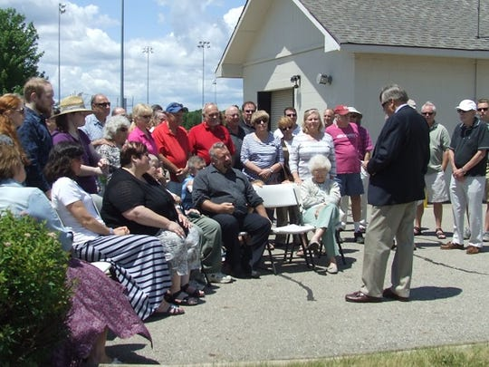 Northville Township Supervisor Bob Nix speaks Saturday to a crowd gathered for the rededication of Northville Community Park as Marv Gans Community Park.