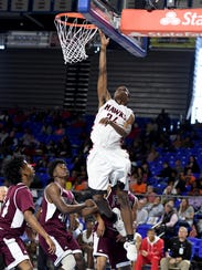South Side's Janias Parram goes up for a lay up over