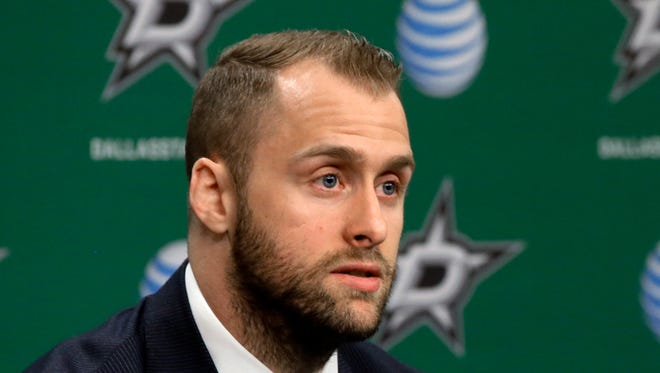 Dallas Stars center Rich Peverley responds to questions during a news conference before the Stars' NHL hockey game against the Nashville Predators.