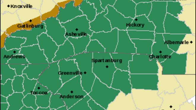 The areas shaded in green are under a flash flood watch through Wednesday afternoon.