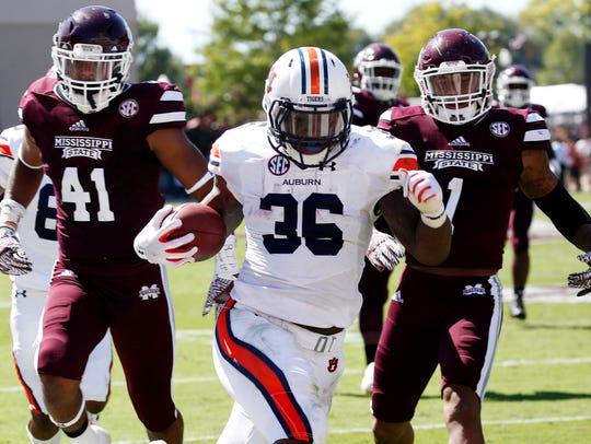 Auburn running back Kamryn Pettway (36) runs past Mississippi