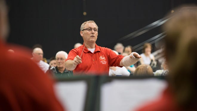 Director Brian Bucec leads the Post Band through music from the 1960s Thursday night at the Kellogg Arena.