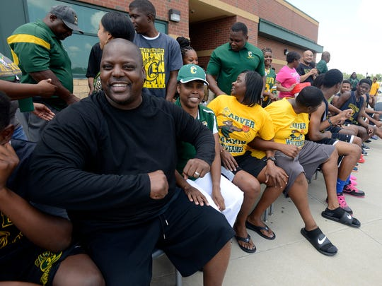 Coach J.J. Jackson and the Carver High School basketball team prepare for the ALS Ice Bucket Challenge at the school in Montgomery, Ala. on Friday August 22, 2014