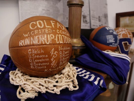 A game ball featuring the team from Colfax High School
