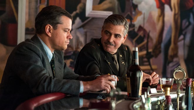 "Matt Damon, left, and George Clooney in a scene from the motion picture ""The Monuments Men."""