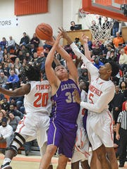 Lexington's Cade Stover found himself surrounded by Tygers most of Tuesday's game.