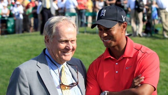 In this June 3, 2012, file photo, Jack Nicklaus, left, talks with Tiger Woods after Woods won the Memorial golf tournament at the Muirfield Village Golf Club in Dublin, Ohio.