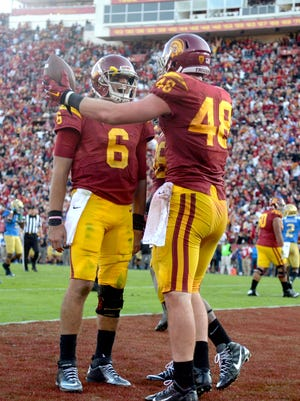 Southern California Trojans quarterback Cody Kessler (6) celebrates with tight end Taylor McNamara (48) after they connected on a 7-yard touchdown pass against the UCLA Bruins in the fourth quarter during an NCAA football game at Los Angeles Memorial Coliseum.