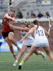 Penfield's Morgan Cox gets off a shot on goal while