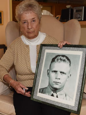 Hazel Robinson, 90, of Hyde Park holds a photo of her deceased first husband, William A. C. Wood Jr., who died while fighting in the Korean War. His remains have yet to be recovered.