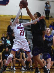 Reno's Mikayla Shults (23) has her shot blocked by by McQueen's Alisi Peaua (50) during their basketball game at Reno on Feb. 9, 2018.