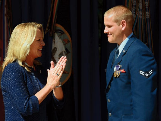 Secretary of the Air Force Deborah Lee James congratulates Airman 1st Class Spencer Stone at the Heroes of the Rails ceremony at the Pentagon in Washington, D.C., Sept. 17. Stone was awarded the Airman's Medal and the Purple Heart for bravery and valor during his heroic actions on the train bound for Paris.