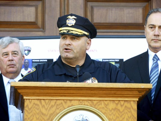York City Police Chief Wes Kahley is flanked by York County District Attorney Tom Kearney, left, and ATF Philadelphia Field Division Special Agent in Charge Sam Rabadi during a press conference on drug and gang-related arrests in York in September 2014. Twelve alleged gang members from York are on trial in federal court in Harrisburg.