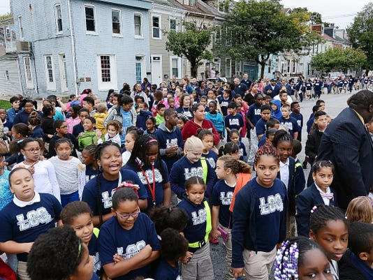 Lincoln Charter School students walk along Princess St. during a Walk to School Day event near the city school Wednesday, Oct. 7, 2015. The international event stresses exercise and pedestrian safety while walking and biking. The entire Lincoln student body walked a round-trip of four blocks from the school to mark the event. Bill Kalina - bkalina@yorkdispatch.com