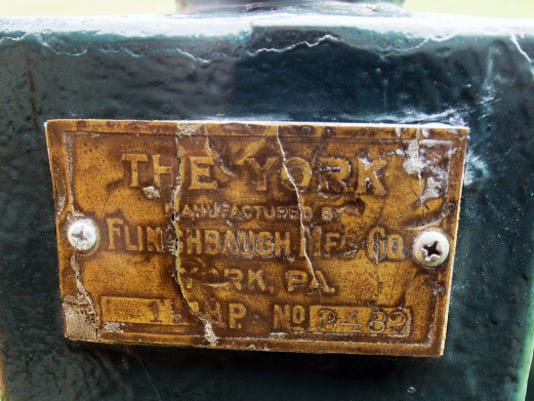 The brass label on one of the hit and miss engines owned by Harry Wildasin Jr.