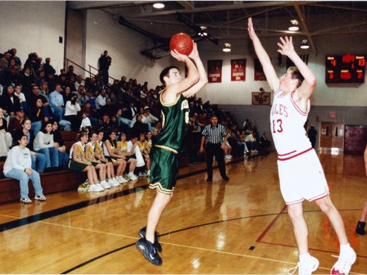Fairfield's Andy Winebrenner shoots a jumper against Bermudian Springs during the 2000-01 season. After posting a .500 record in the regular season, Winebrenner and his teammates advanced to the PIAA Class A title game, a run that excited the community. 'People would be waiting for us at midnight to support us or open the pizza shop. It was a very special time,' player Tommy Dowd said.