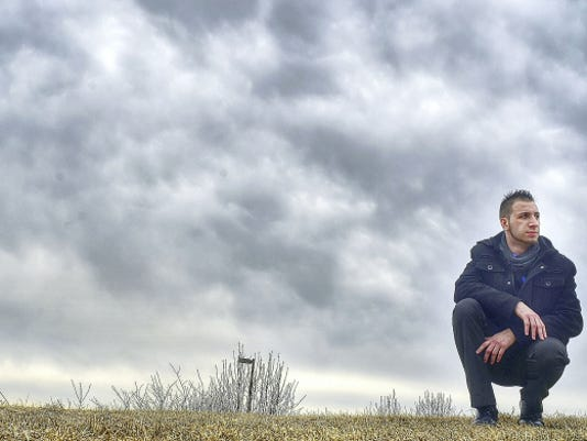 Jacob Ruth pauses behind Grace Fellowship Church in Shrewsbury last month. Ruth says the walk from his home to the church gives him time to reflect on where he's been the past year and where he is now in his life and drug recovery. Ruth tells his story in a video at yorkdispatch.com.