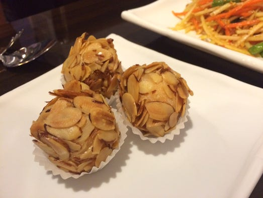 Shrimp balls encased in an armor of slivered almonds.