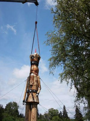 The removal of the giant nutcracker in River Forks County Park was delayed Tuesday when workers discovered that a barn owl had built a nest and laid eggs in the back of the nutcracker.