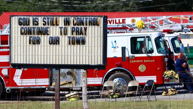 A sign outside of the Townville Fire Department on Sunday, Oct. 2, 2016, asks for continued prayers for the community.