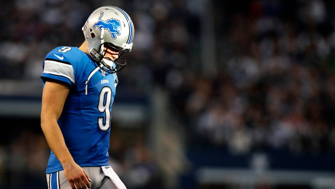 Detroit Lions quarterback Matthew Stafford (9) reacts during the second quarter against the Dallas Cowboys in the NFC Wild Card Playoff Game at AT&T Stadium.