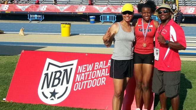 Keturah Orji, center, poses with Mount Olive coaches Vanessa Benfatti and Sirajj Ziyad after winning the New Balance Nationals long jump on Sunday afternoon in Greensboro, N.C.