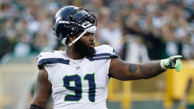 Sheldon Richardson of the Seattle Seahawks gestures during the fourth quarter against the Green Bay Packers at Lambeau Field on September 10, 2017 in Green Bay, Wisconsin.