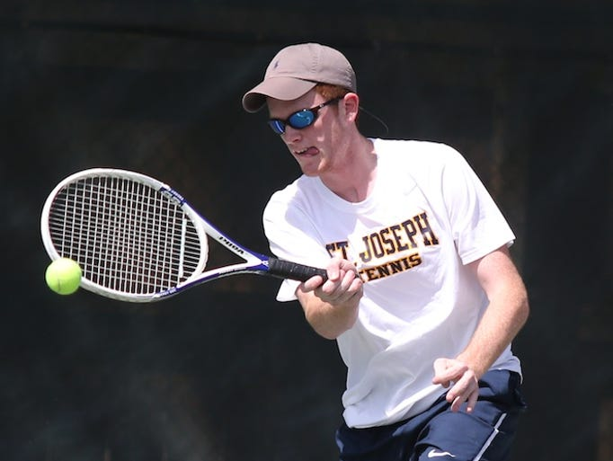 St. Joe's Matthew Harkey returns a serve during the MHSAA Class 2A Mixed Doubles Championships. The MHSAA tennis championships were held at Parham Bridges Park in Jackson on  Friday, May 2, 2014. Photo by Keith Warren