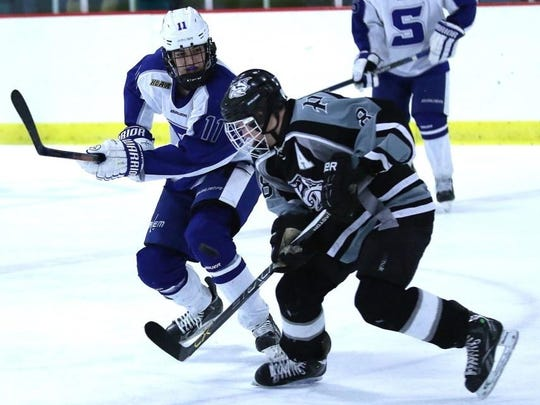 Trying to skate past Salem's Marty Mills (No. 11) Wednesday