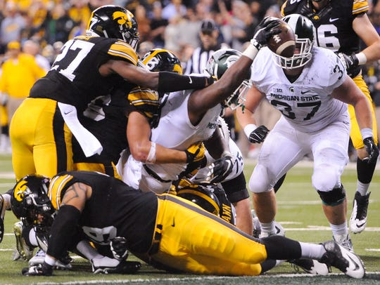 Michigan State's LJ Scott (3) scores a touchdown in