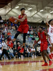 New Albany's Romeo Langford (1) pulls in a rebound