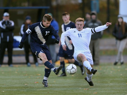 Sutherland's John Mozrall (27) gets a shot off.