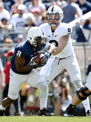 Penn State quarterback Trace McSorley hands the ball