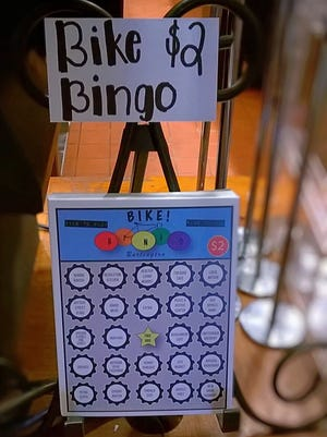 A rack of Burlington Bike! Bingo cards on display recently at New Moon Cafe in Burlington. The game, organized by Bicycle Benefits, is designed to promote biking.