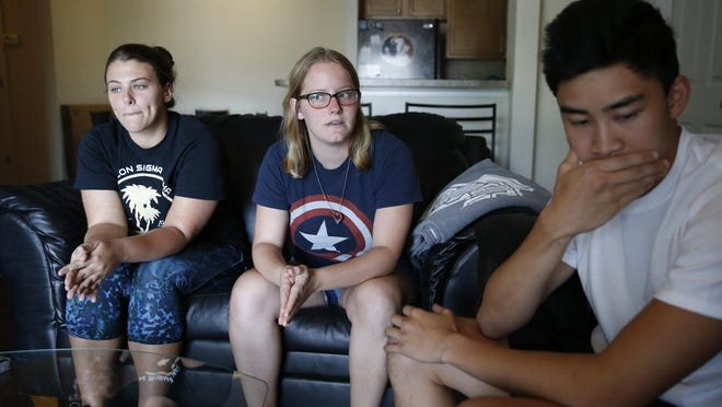 Zach Fadullin, from right, Christine Mucci and Natalie Jones talk about the group of friends they have that were involved in a fatal accident on Sunday.