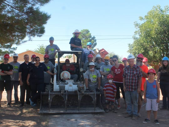 The entire crew of Saturday's demolition stand together.