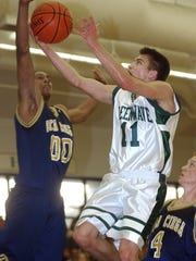 Matt Hill of Fort Myers High School goes up for a shot while Marquel Brooks of Boca Ciega High School tries to block during the Region 5A-3 semifinals on March 5, 2003.