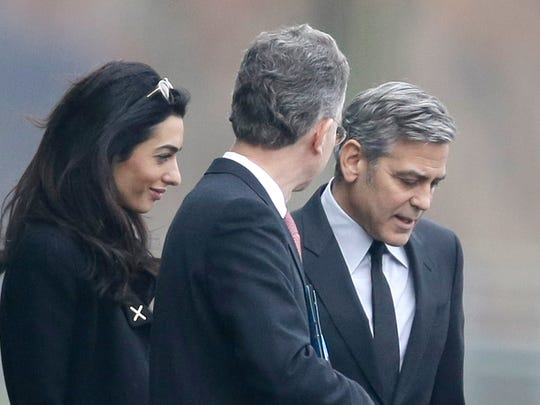 George Clooney, right, and his wife Amal Clooney, after
