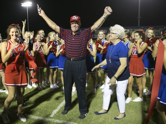 Former Mountain View coach Jesse Parker cuts the ribbon for the renaming of the football field at Mountain View High School on Fri, Aug. 26, 2016 in Mesa, Ariz. Parker died in 2017.