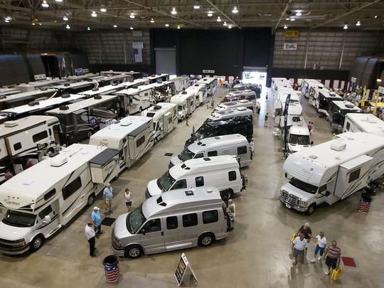 Scene from a previous year. The Fort Myers RV show has vehicles indoors and outdoors.