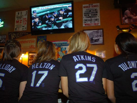 Colorado Rockies fans from left, Abby Hammon, Cara O'Connor, Caitlin McGuire and Christina Kanai, wear their Rockies t-shirts as they watch the first game of the World Series against the Boston Red Sox at Old Chicago's in Fort Collins Wednesday Oct. 24, 2007.