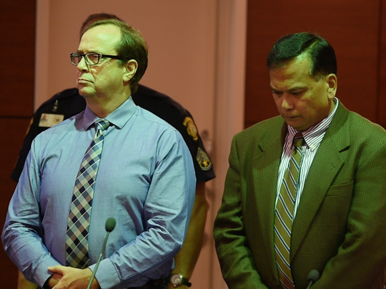 University of Guam professor Michael Ehlert, left, reacts to his verdict at the Superior Court of Guam on July 31, 2017. He was found guilty of one count of third-degree criminal sexual conduct and one count of attempted third-degree criminal sexual conduct against two students.