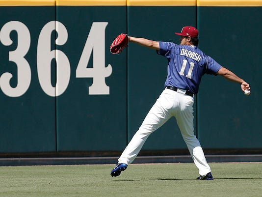 Rehabbing with the Frisco Rough Riders, Texas Rangers starting pitcher Yu Darvish warms up in the outfield before a Double-A baseball game against the Corpus Christi Hooks at Dr. Pepper Ballpark in Frisco, Texas, Sunday, May 1, 2016. (Brandon Wade/Star-Telegram via AP) MAGS OUT (FORT WORTH WEEKLY, 360 WEST); INTERNET OUT