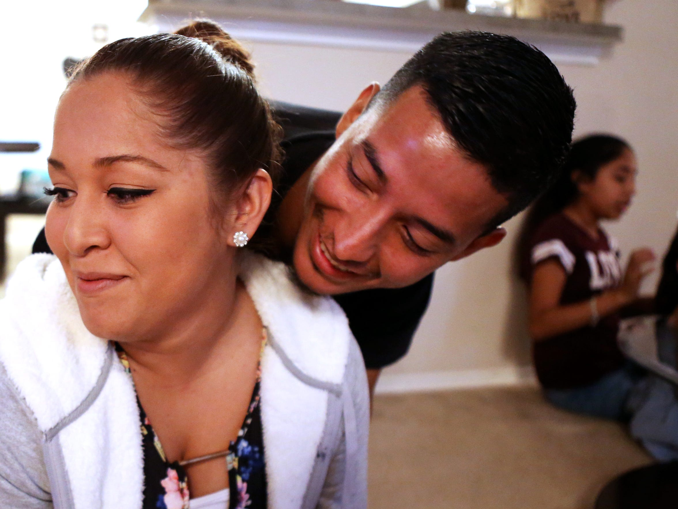 Naomi and Ezequiel Rojas Martinez steal a moment together while visiting family on Nov. 2, 2017.