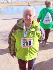 Della Simmons turned out for the estimated walk at Isleta Lakes.