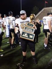 Army veteran Bradley Boone helped start the football