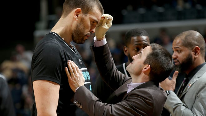Memphis Grizzlies Marc Gasol has bleeding on his forehead stopped by Assistant Athletic Trainer/Strength and Conditioning Jim Scholler during the game against the Golden State Warriors at FedExForum on Feb. 9, 2017.