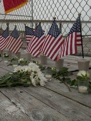 A memorial March 12, 2015, reminds Navarre Pier visitors