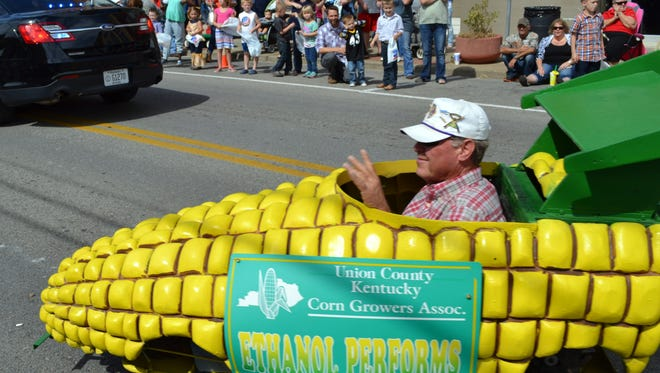 "The Lions Club h put on the Morganfield Corn Festival  for some 30 years.  Here club member Gary Stenger rides in the parade favorite ""corn car.'"